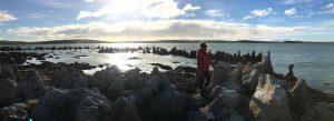 TDF-Woman-Walking-On-Rocky-Shore-5-14-20